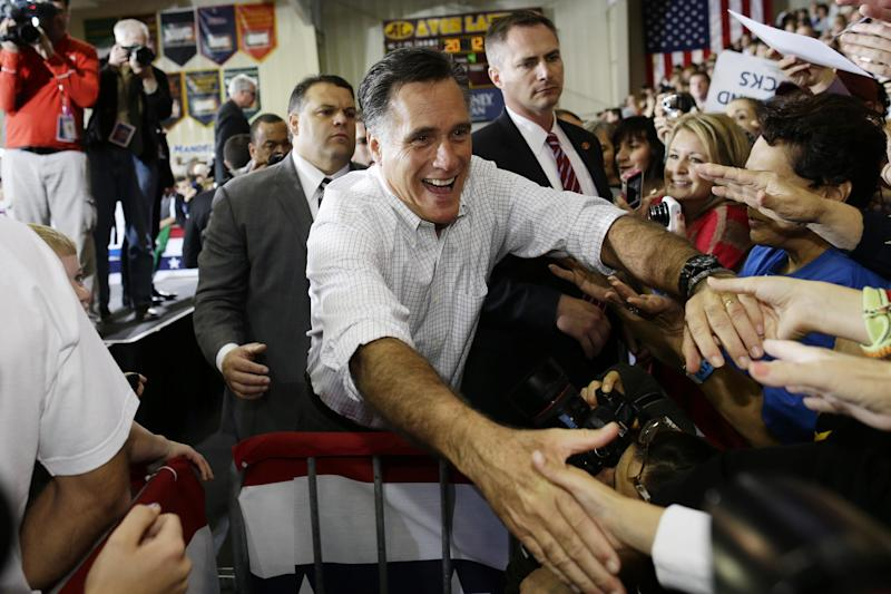 Republican presidential candidate, former Massachusetts Gov. Mitt Romney greets supporters as he campaigns at Avon Lake High School in Avon Lake, Ohio, Monday, Oct. 29, 2012. (AP Photo/Charles Dharapak)