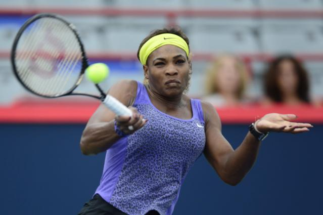 Serena Williams returns to Samantha Stosur of Australia, at the Rogers Cup tennis tournament Wednesday Aug. 6, 2014 in Montreal. (AP Photo/The Canadian Press, Paul Chiasson)