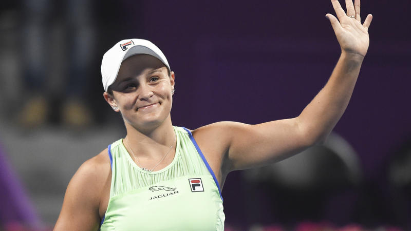 Ash Barty is pictured waving to fans after winning a match at the 2020 Qatar Open.