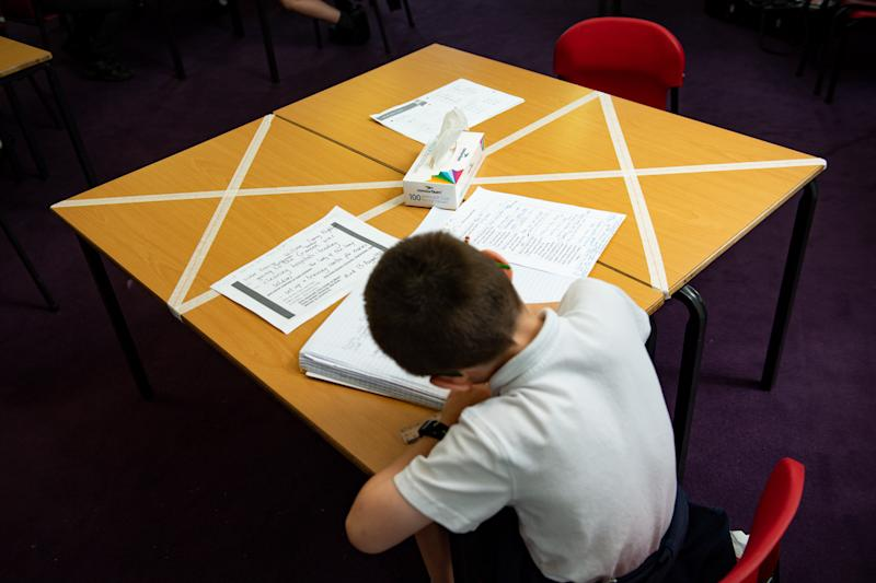 Social distancing measures as a child studies on a marked table at Kempsey Primary School in Worcester. Nursery and primary pupils could return to classes from June 1 following the announcement of plans for a phased reopening of schools. (Photo by Jacob King/PA Images via Getty Images)