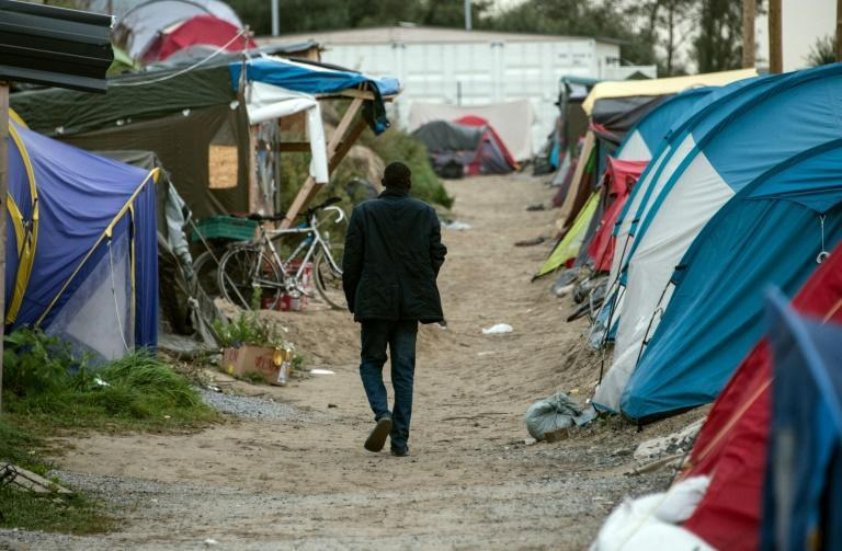 """The so-called """"Jungle"""" migrant camp in Calais is home to thousands of migrants hoping to make their way to Britain"""