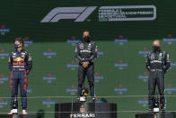 Second placed Red Bull driver Max Verstappen of the Netherlands, winner Mercedes driver Lewis Hamilton of Britain and third placed Mercedes driver Valtteri Bottas of Finland, from left, stand on the podium of the Portugal Formula One Grand Prix at the Algarve International Circuit near Portimao, Portugal, Sunday, May 2, 2021. (AP Photo/Manu Fernandez)