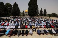 Palestinians pray at the compound that houses Al-Aqsa Mosque, known to Muslims as Noble Sanctuary and to Jews as Temple Mount, in Jerusalem's Old City
