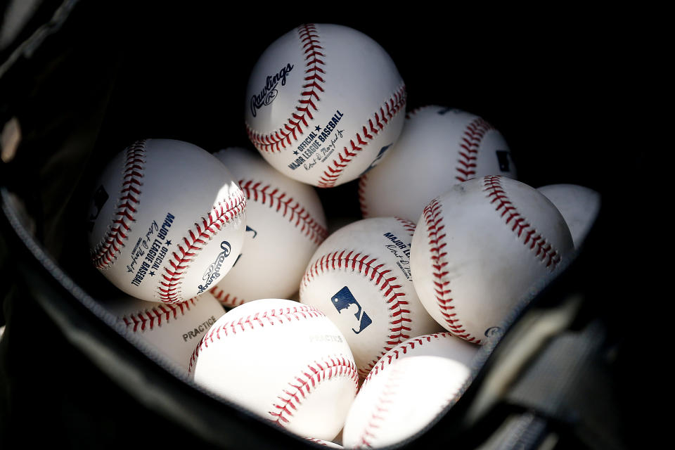 VARIOUS CITIES,  - MARCH 12:  A detail of baseballs during a Grapefruit League spring training game between the Washington Nationals and the New York Yankees at FITTEAM Ballpark of The Palm Beaches on March 12, 2020 in West Palm Beach, Florida. Many professional and college sports, including the MLB, are canceling or postponing their games due to the ongoing threat of the Coronavirus (COVID-19) outbreak. (Photo by Michael Reaves/Getty Images)