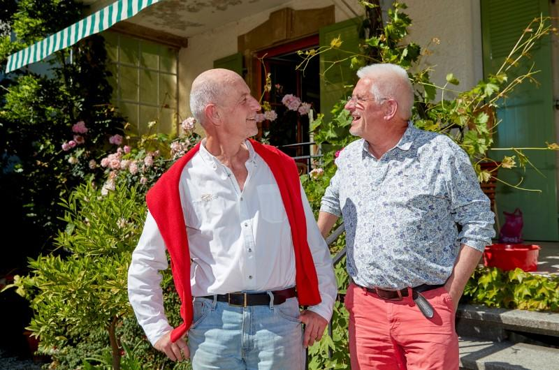Bugnon and Marmier pose in their garden in Lausanne