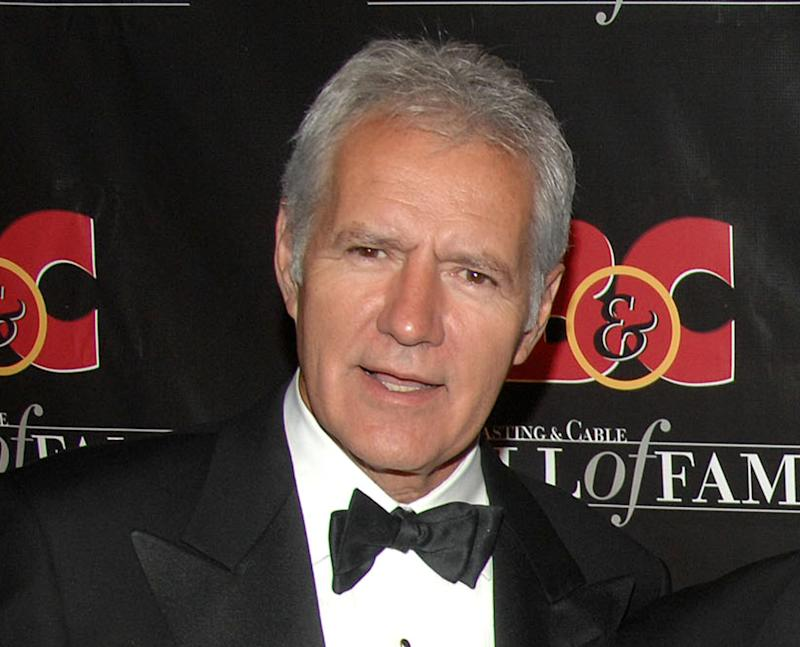 "FILE - this Oct. 22, 2007 file photo shows game show host Alex Trebek at the 17th annual Broacasting and Cable Hall of Fame awards dinner in New York. Trebek remains in a Los Angeles hospital recovering from a mild heart attack. But Sony Pictures Television spokeswoman Paula Askanas said Monday, June 25, 2012 that Trebek is ""up and about and in good spirits"" while doctors complete their tests. He has been moved to a regular room, she said. The 71-year-old Trebek was admitted to Cedars-Sinai Medical Center on Saturday. (AP Photo/Peter Kramer, file)"