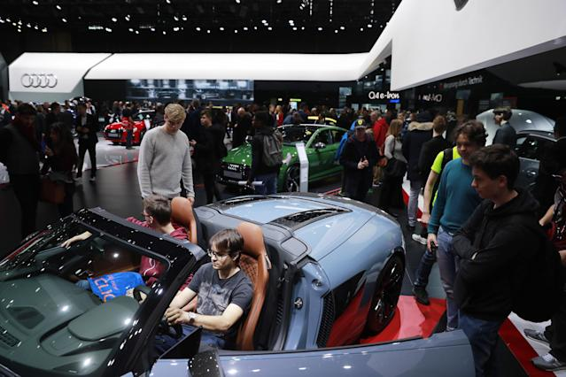 People at the 89th Geneva International Motor Show in 2019. (Photo by Sergei Fadeichev/TASS via Getty Images)