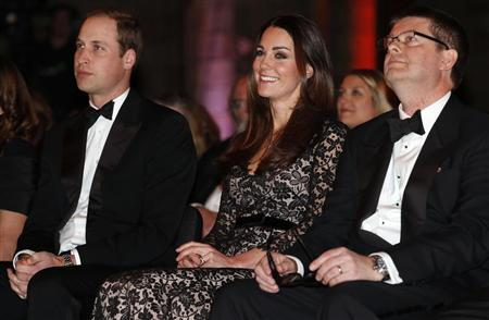 """Britain's Prince William and his wife Catherine, the Duchess of Cambridge, sit with Natural History Museum Director Dixon before a screening of """"David Attenborough's Natural History Museum Alive 3D"""" in London"""