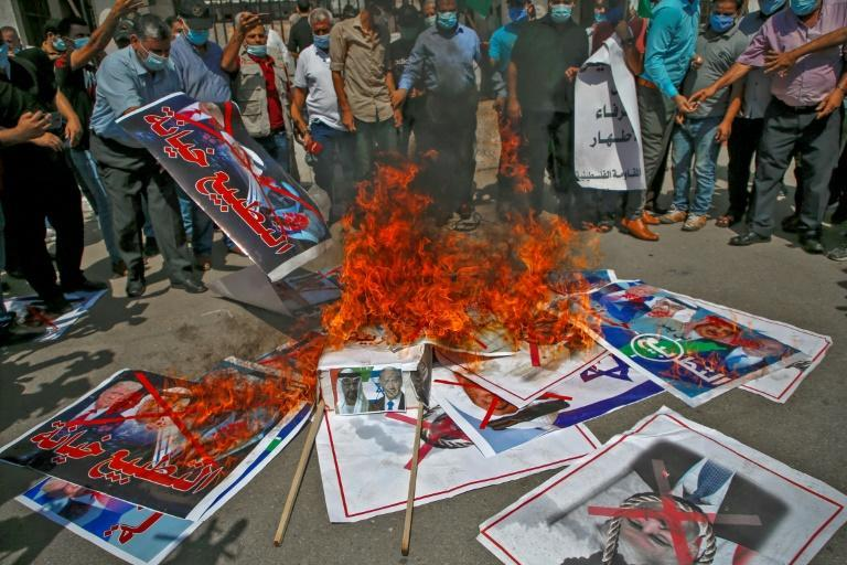 In the Gaza Strip, protesters trampled and set fire to placards showing Israeli Prime Minister Benjamin Netanyahu, Bahrain's King Hamad bin Isa Al-Khalifa and the UAE's Sheikh Mohamed bin Zayed Al-Nahyan