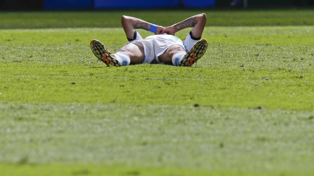 Argentina's Angel di Maria lays on the pitch after getting injured during the World Cup quarterfinal soccer match between Argentina and Belgium at the Estadio Nacional in Brasilia, Brazil, Saturday, July 5, 2014. (AP Photo/Frank Augstein)
