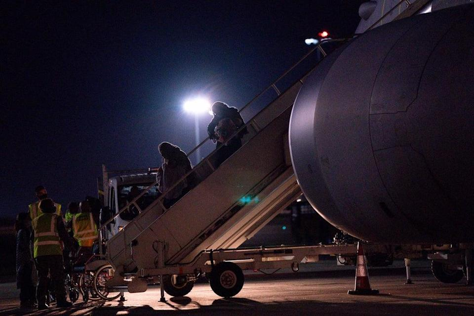 British nationals and Afghan arrive on a flight from Afghanistan at RAF Brize Norton (Jacob King/PA) (PA Wire)