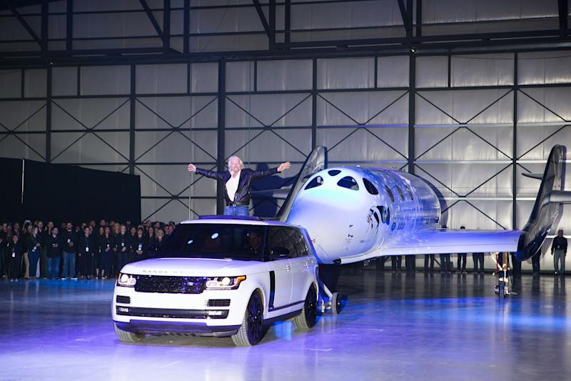 Virgin Group founder Richard Branson stands before Virgin Spaceship Unity, otherwise known as SpaceShipTwo, during its unveiling at the company's Mojave, California, headquarters in 2016. VSS Unity is built by Virgin-owned The Spaceship Company, and is a new craft designed in the wake of a 2014 flight in which a pilot died.