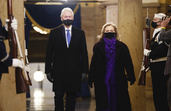 Former President Bill Clinton, left, and former Secretary of State Hillary Clinton arrive in the Crypt of the US Capitol for President-elect Joe Biden's inauguration ceremony on Wednesday, Jan. 20, 2021 in Washington. (Jim Lo Scalzo (Jim Lo Scalzo/Pool Photo via AP)