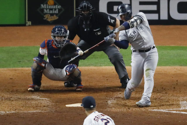 New York Yankees' Gleyber Torres hits a home run off Houston Astros starting pitcher Zack Greinke during the sixth inning in Game 1 of baseball's American League Championship Series Saturday, Oct. 12, 2019, in Houston. (AP Photo/Sue Ogrocki)