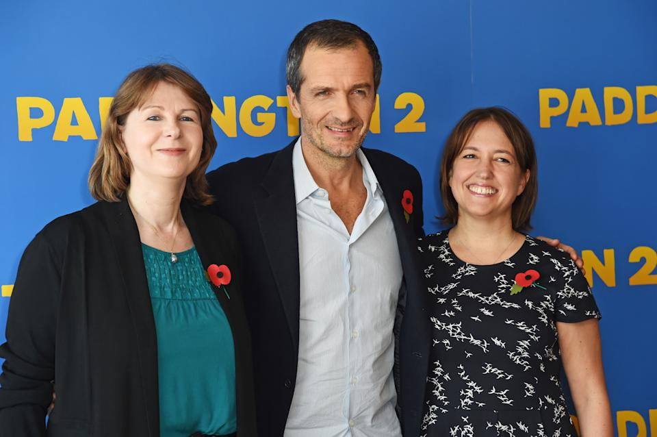 "LONDON, ENGLAND - NOVEMBER 03:  (L to R) Rosie Alison, David Heyman and Alexandra Ferguson-Derbyshire attend a photocall for ""Paddington 2"" at Shangri-La Hotel, The Shard, on November 3, 2017 in London, England.  (Photo by David M. Benett/Dave Benett/WireImage)"