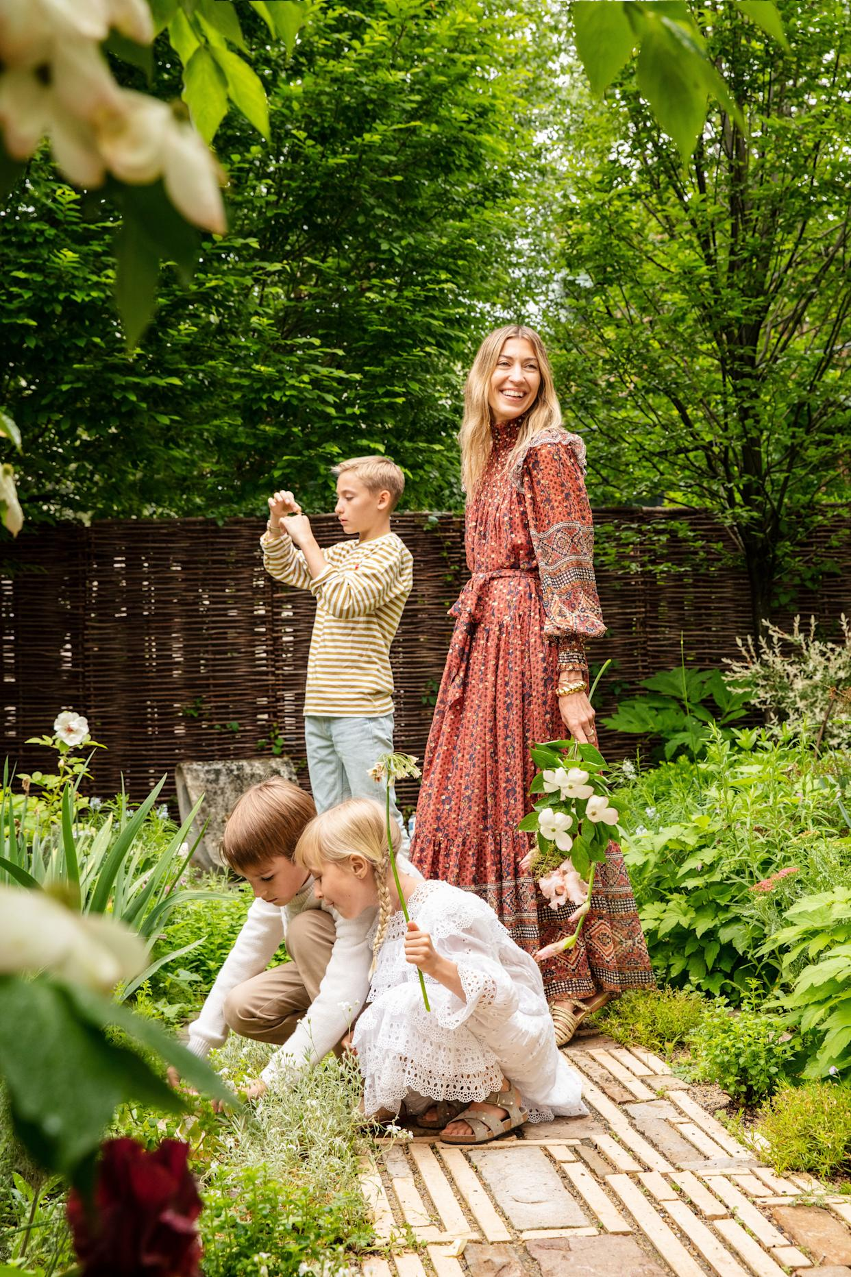 """<div class=""""caption""""> Johnson and her children in the garden. </div>"""