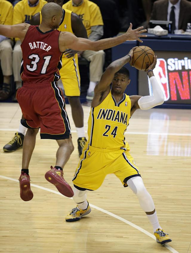 Indiana Pacers forward Paul George (24) looks to pass under the defense of Miami Heat forward Shane Battier (31) during the first half of Game 1 of the Eastern Conference finals NBA basketball playoff series Sunday, May 18, 2014, in Indianapolis. (AP Photo/AJ Mast)