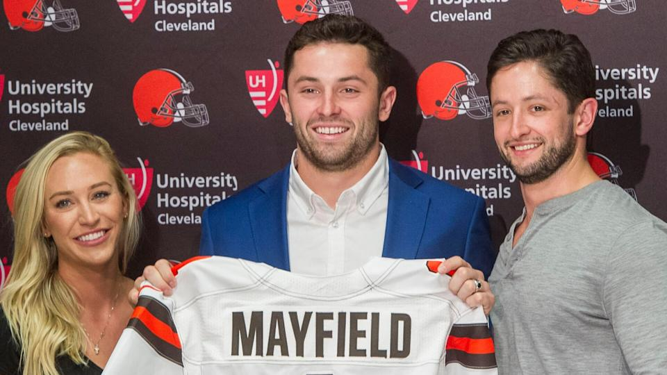 Mandatory Credit: Photo by Phil Long/AP/Shutterstock (9644685b)Cleveland Browns first-round draft pick Baker Mayfield, center, stands with his girlfriend, Emily Wilkinson, and brother Matt Mayfield after a news conference at the NFL football team's headquarters in Berea, Ohio, .