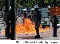 Greek citizens are rioting and attacking police, as in this photo, in protest of drastic budget cuts the EU and IMF have required in exchange for a financial bailout.