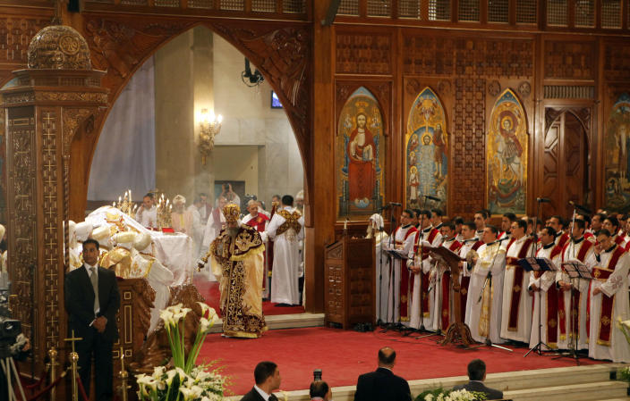 Pope Tawadros II, the 118th pope of the Coptic Church of Egypt, center, leads the Easter Mass at St. Mark's Cathedral in Cairo, Egypt, late Saturday May 4, 2013. Egypt's Coptic Christians, who make up about 10 percent of the country's 85 million people, have long complained of discrimination by the state. They are the largest Christian community in the Middle East. (AP Photo/Amr Nabil)