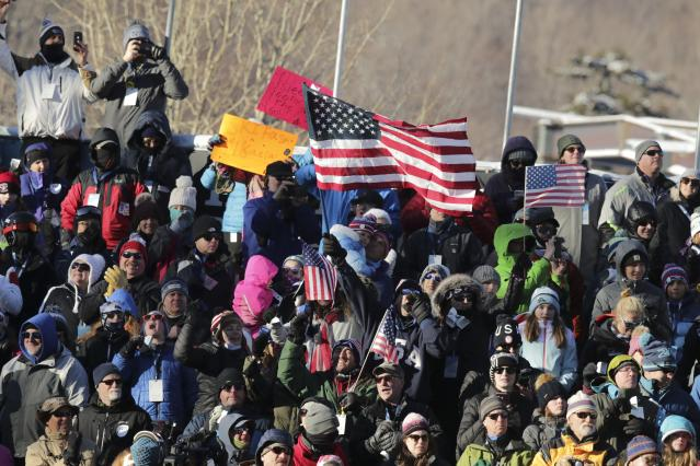 Spectators follow an alpine ski, women's World Cup giant slalom in Killington, Vt., Saturday, Nov. 30, 2019. (AP Photo/Charles Krupa)