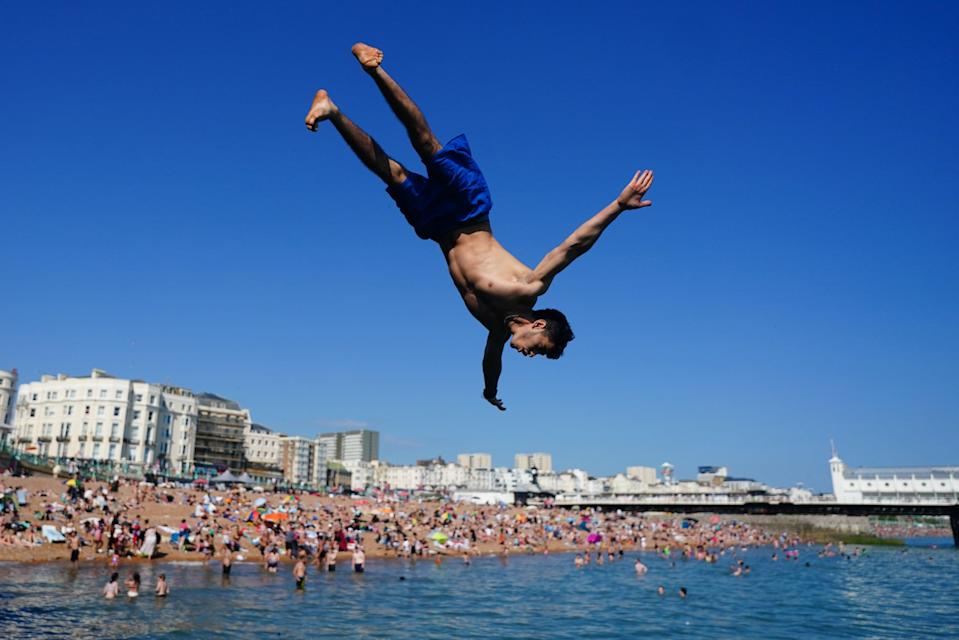 People have been heading to the beach to cool down (Victoria Jones/PA) (PA Wire)