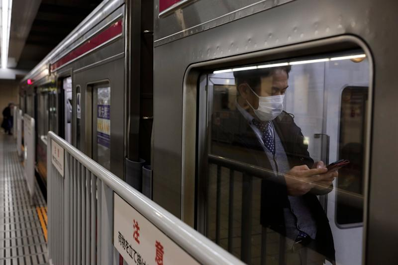 A commuter wearing a mask waits for a train to depart at Shinjuku Station in Tokyo, Monday, Jan. 27, 2020. Japan said Monday it is preparing to send chartered flights to China to evacuate Japanese citizens out of Wuhan, the epicenter of as the new coronavirus outbreak, as the death toll and the number of patients rapidly increase and transportation in and out of the city is cut off. (AP Photo/Jae C. Hong) (Photo: ASSOCIATED PRESS)