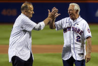 Former New York Yankees manager Joe Torre, left, and former New York Mets manager Bobby Valentine react after they threw out ceremonial first pitches before a baseball game Saturday, Sept. 11, 2021, in New York. (Andrew Mills/NJ Advance Media via AP)