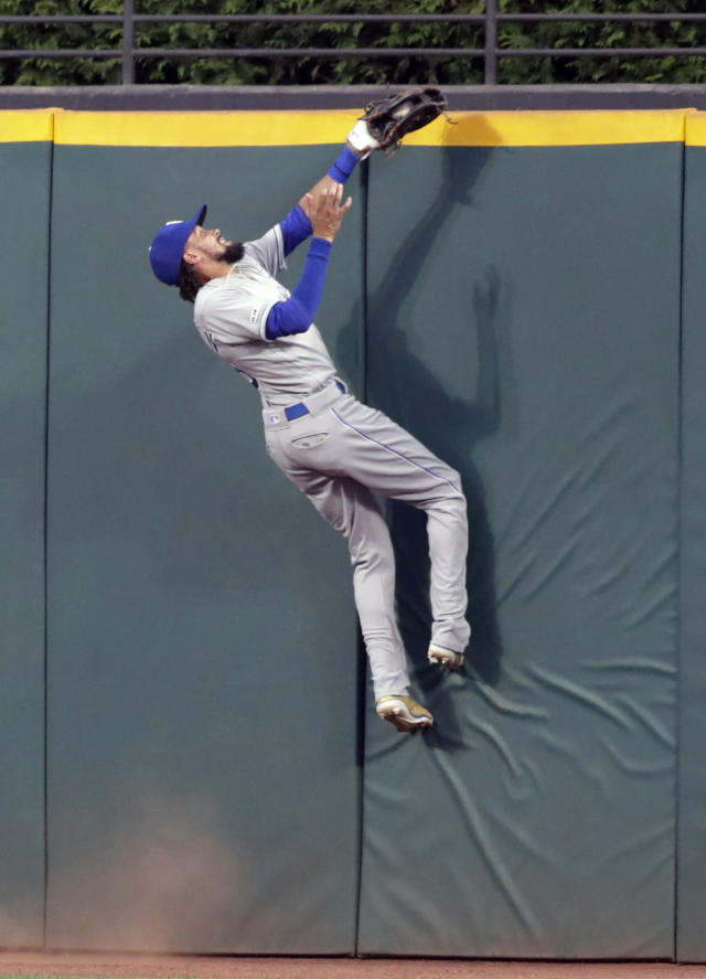 Kansas City Royals' Billy Hamilton catches a ball hit by Cleveland Indians' Francisco Lindor in the sixth inning of a baseball game, Saturday, July 20, 2019, in Cleveland. Lindor was out on the play. (AP Photo/Tony Dejak)