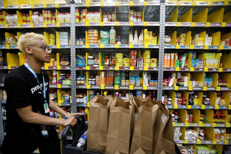 An employee works at Amazon's Prime Now fulfillment centre in Singapore July 27, 2017. REUTERS/Edgar Su
