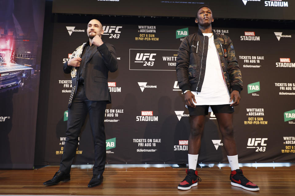 MELBOURNE, AUSTRALIA - AUGUST 15: Robert Whittaker (L) and Israel Adesanya (R) pose during a UFC Australia press conference at Federation Square on August 15, 2019 in Melbourne, Australia. (Photo by Daniel Pockett/Zuffa LLC/Zuffa LLC via Getty Images)