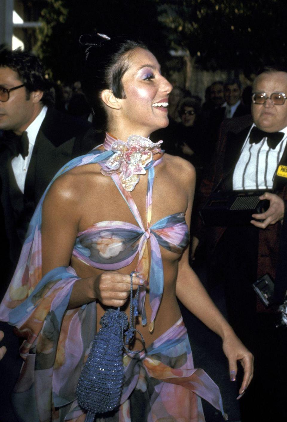 <p>Cher, in one of her iconic outfits, attended 1974's 46th Annual Academy Awards.</p>