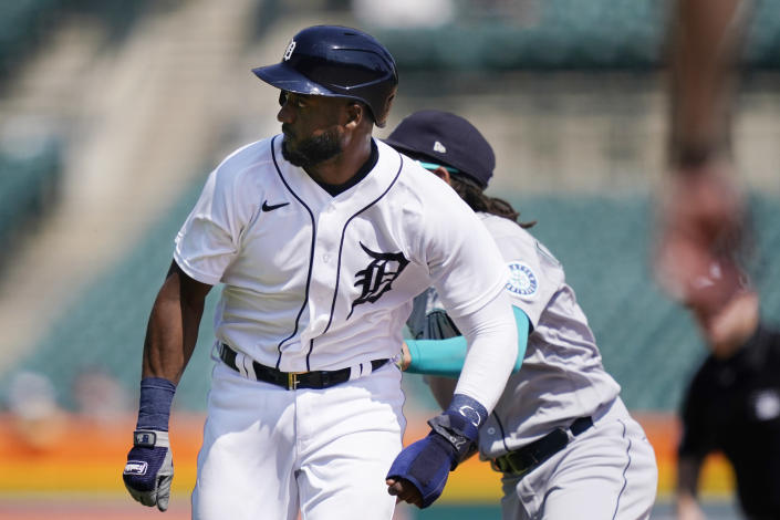 Detroit Tigers' Niko Goodrum is tagged by Seattle Mariners shortstop J.P. Crawford in a rundown between first and second during the seventh inning of a baseball game, Thursday, June 10, 2021, in Detroit. (AP Photo/Carlos Osorio)