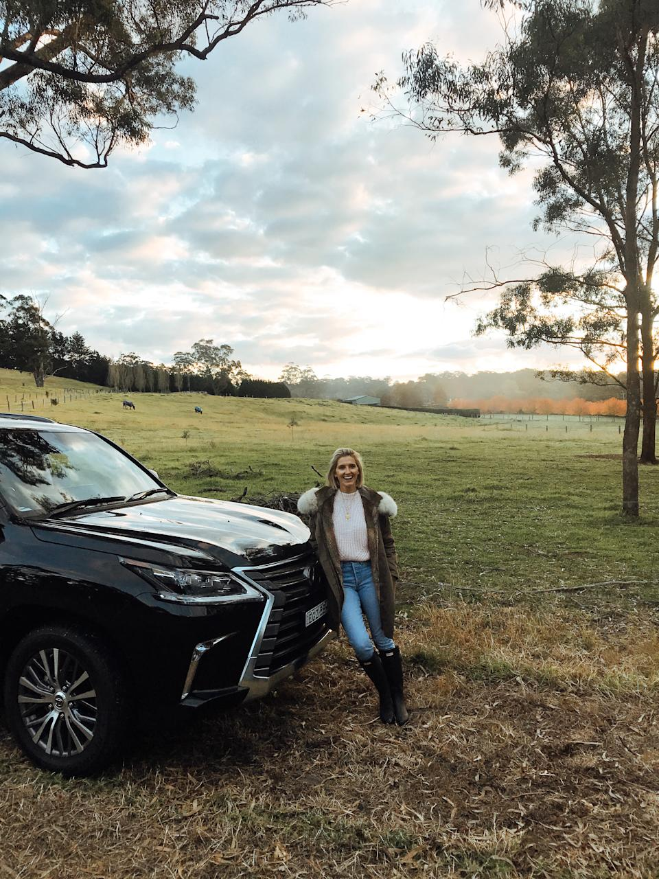 Kate Waterhouse leaning against a Lexus LX four-wheel-drive in the Southern HIghlands