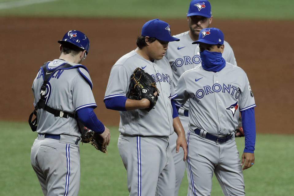 Toronto Blue Jays starting pitcher Hyun-Jin Ryu, of Korea, center, gets taken out of the game by manager Charlie Montoya, right, as catcher Danny Jansen, left, looks on during the fifth inning of a baseball game against the Tampa Bay Rays Friday, July 24, 2020, in St. Petersburg, Fla. (AP Photo/Chris O'Meara)