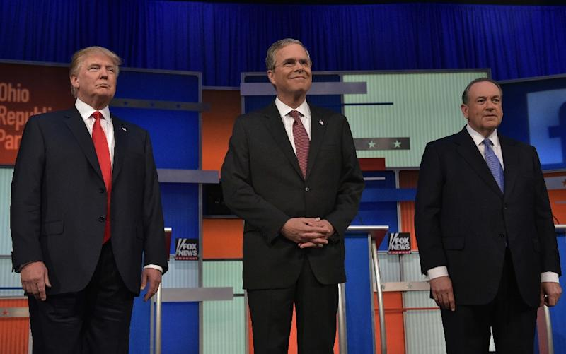 L-R: Real estate tycoon Donald Trump, former Florida governor Jeb Bush and former Arkansas governor Mike Huckabee participate in the Republican presidential primary debate on August 6, 2015 at the Quicken Loans Arena in Cleveland, Ohio (AFP Photo/Mandel Ngan)