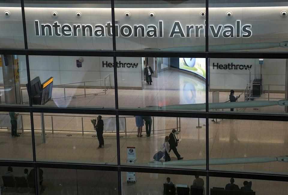 Passengers in the international arrivals hall at Terminal 2 of London Heathrow Airport (Steve Parsons/PA) (PA Wire)