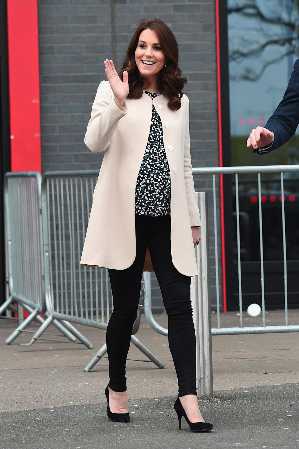 <p>Catherine, Duchess of Cambridge, wearing a simple cream coat, floral blouse, and skinny trousers at the Copperbox Arena on March 22, 2018, in London. (Photo: Getty Images) </p>