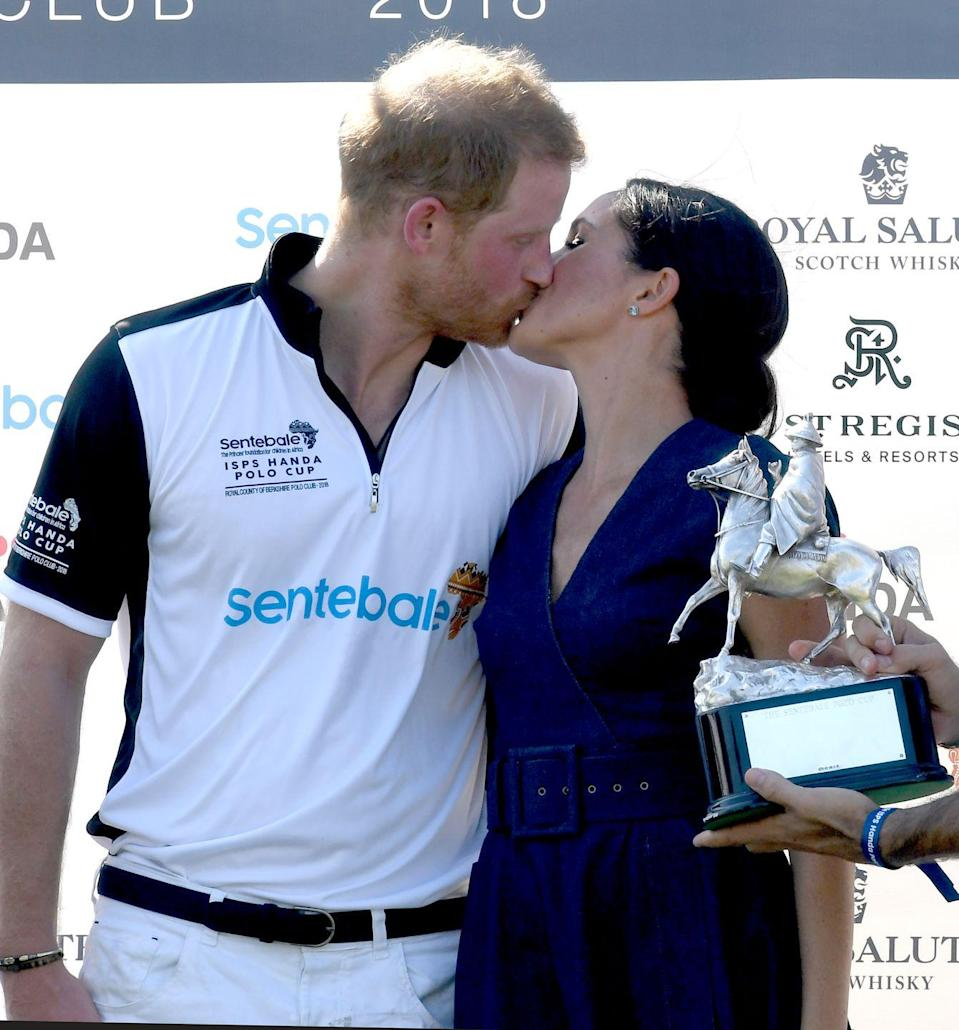 """<p>The couple shared a smooch at the polo following <a href=""""https://www.elle.com/uk/fashion/celebrity-style/a22559039/meghan-markle-carolina-herrera-navy-blue-dress-polo/"""" rel=""""nofollow noopener"""" target=""""_blank"""" data-ylk=""""slk:Prince Harry's triumphant return to the pitch"""" class=""""link rapid-noclick-resp"""">Prince Harry's triumphant return to the pitch</a> and, we're in love, July 2018. </p>"""