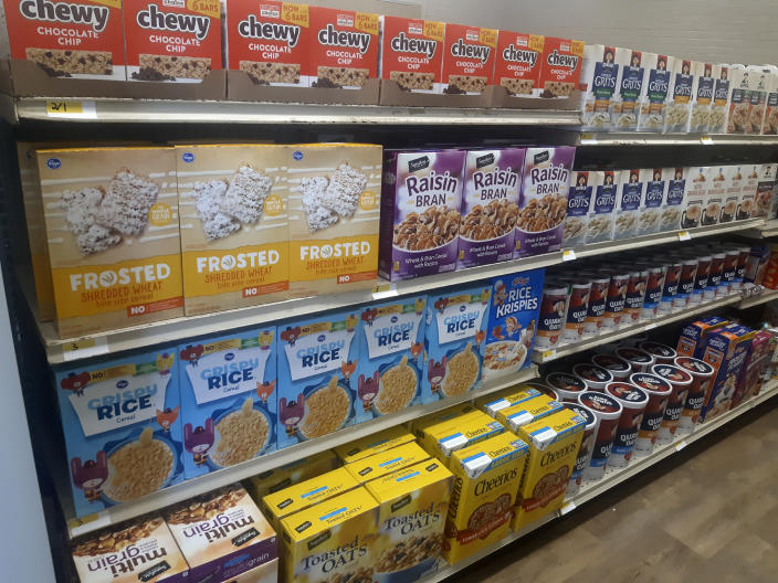 In this photo provided by Paul Juarez, cereal and other foods line the shelves of Linda Tutt High School's student-led grocery store on Nov. 20, 2020, in Sanger, Texas. (Paul Juarez via AP)