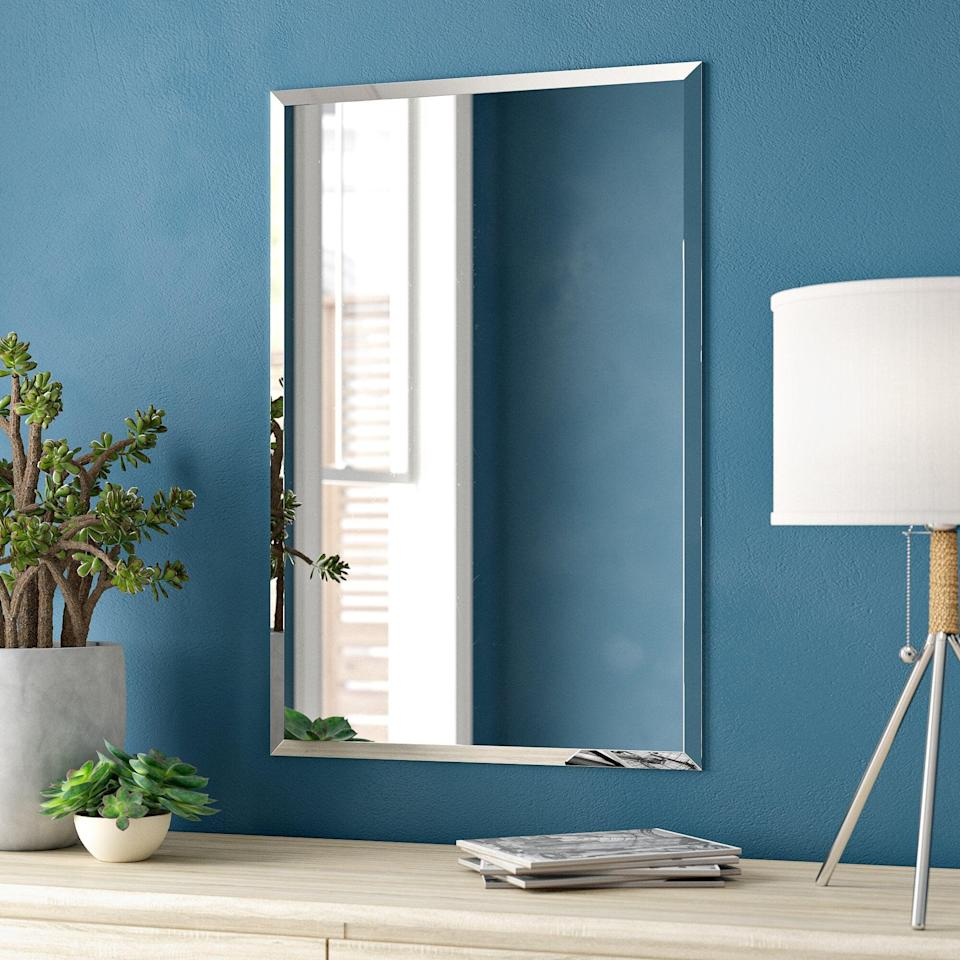 <p>The <span>Lithonia Modern and Contemporary Beveled Frameless Vanity Mirror</span> ($84, originally $92) adds a regal and sleek touch to your vanity.</p>