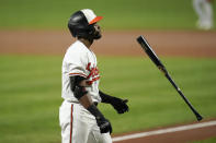 Baltimore Orioles' Cedric Mullins flips his bat after striking out against Boston Red Sox starting pitcher Nathan Eovaldi during the first inning of a baseball game, Wednesday, Sept. 29, 2021, in Baltimore. (AP Photo/Julio Cortez)