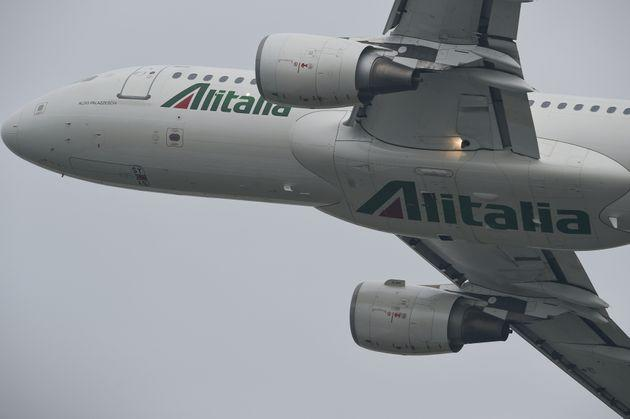 """The Airbus A320 of the Italian flag carrier """"Alitalia"""" flies over the skies of Milan Linate International Airport Airport during the Linate Air Show 2019 (Photo by Andrea Diodato/NurPhoto via Getty Images)"""