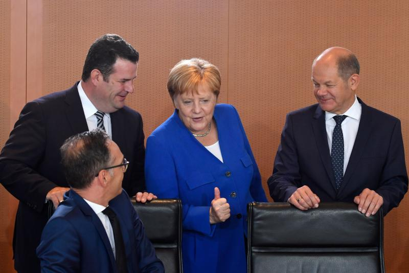 German Chancellor Angela Merkel (2nd R) gives a thumbs up as she talks with German Finance Minister and Vice-Chancellor Olaf Scholz (R), German Foreign Minister Heiko Maas (L, sitting) and German Labour Minister Hubertus Heil prior to the weekly cabinet meeting on August 21, 2019 at the Chancellery in Berlin. Photo: JOHN MACDOUGALL/AFP via Getty Images