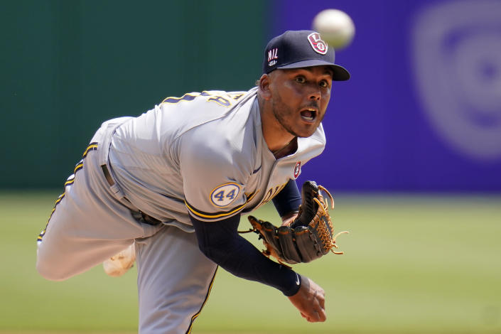 Milwaukee Brewers relief pitcher Freddy Peralta delivers during the first inning of a baseball game against the Pittsburgh Pirates in Pittsburgh, Sunday, July 4, 2021. (AP Photo/Gene J. Puskar)