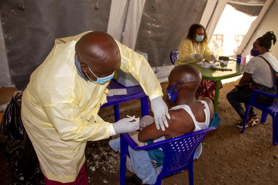 A medical worker administers a dose of COVID-19 vaccine for a man in Goma, northeast Democratic Republic of the Congo DRC, on Oct. 8, 2021. (Photo by Zanem/Xinhua via Getty Images)