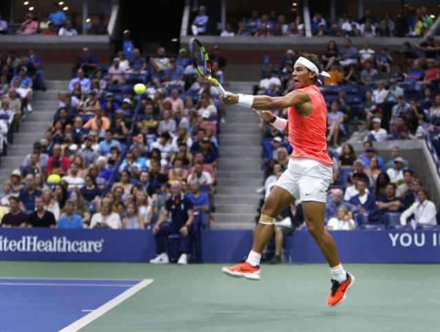 "<a class=""link rapid-noclick-resp"" href=""/olympics/rio-2016/a/1195086/"" data-ylk=""slk:Rafael Nadal"">Rafael Nadal</a>, of Spain, returns a shot to Karen Khachanov, of Russia, during the third round of the U.S. Open tennis tournament, Friday, Aug. 31, 2018, in New York. (AP Photo/Jason DeCrow)"