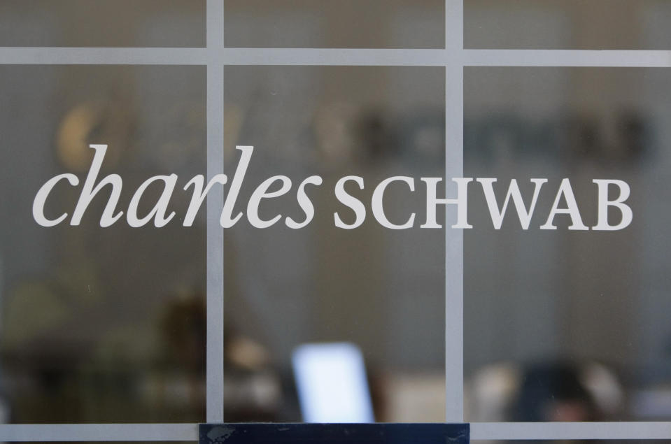 FILE - This July 14, 2010, file photo, shows a Charles Schwab office in Oakland, Calif. Charles Schwab is buying rival TD Ameritrade for $26 billion, a blockbuster deal accelerated by disruption in the online brokerage industry. The tie-up announced Monday, Nov. 25, 2019, would create a company so big, however, that it may draw sharp scrutiny from antitrust regulators.(AP Photo/Paul Sakuma, File)