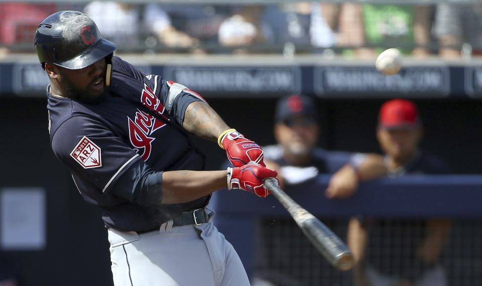 Cleveland Indians' Hanley Ramirez hits a pop fly during the second inning of a spring training baseball game against the San Diego Padres' Monday, March 4, 2019, in Peoria, Ariz. (AP Photo/Ross D. Franklin)
