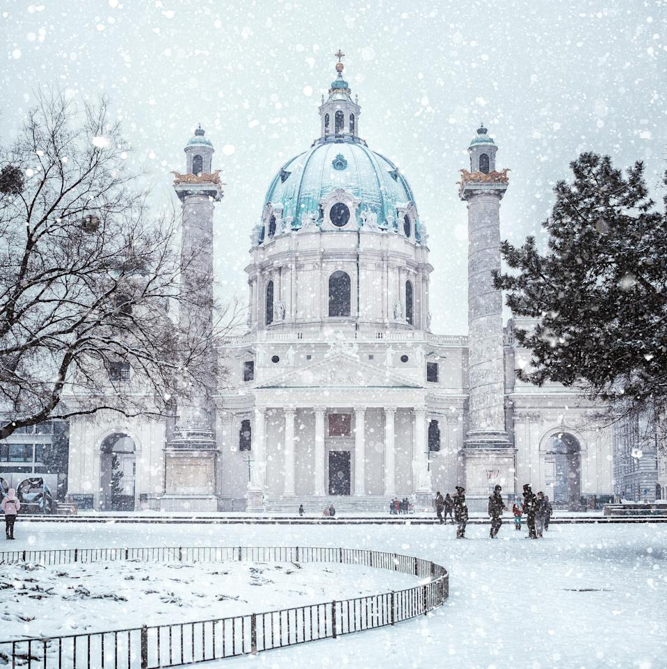 """Vienna was voted <a href=""""https://www.cntraveler.com/galleries/2014-10-20/top-25-cities-in-the-world-readers-choice-awards-2014?mbid=synd_yahoo_rss"""" rel=""""nofollow noopener"""" target=""""_blank"""" data-ylk=""""slk:the best city in Europe"""" class=""""link rapid-noclick-resp"""">the best city in Europe</a> in this year's Readers' Choice Awards—a title that holds true no matter the season. But we're particularly fond of the <a href=""""https://www.cntraveler.com/stories/2015-11-17/a-day-in-vienna-with-aerin-lauder?mbid=synd_yahoo_rss"""" rel=""""nofollow noopener"""" target=""""_blank"""" data-ylk=""""slk:Austrian capital"""" class=""""link rapid-noclick-resp"""">Austrian capital</a> in the winter, when you can double down on hot chocolate and sachertorte, a local chocolate cake, watch free outdoor simulcasts of the opera (loads of people attend, even when it's freezing), listen to classical holiday concerts, and snap photos of Schönbrunn Palace and St. Charles Church (pictured), covered in snow."""